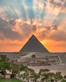 When human creation meets nature  Sunrise at the Great Pyramid of Giza, Egypt.